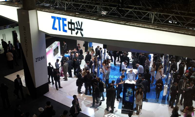 Mid-range shot of a ZTE booth at a mobile exhibition in Asia.