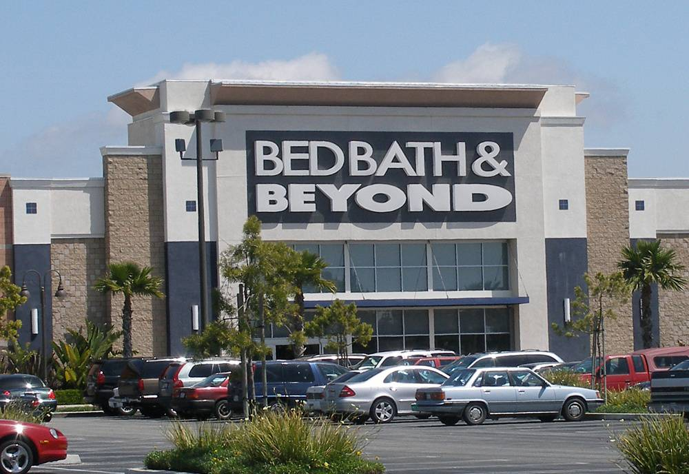 Tens of cars on a parking in front of a Bed Bath & Beyond store