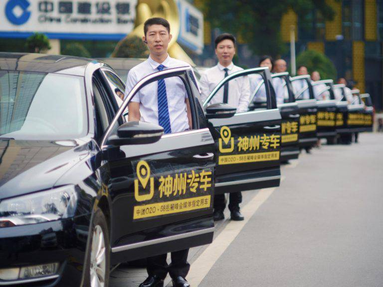 Fleet of taxi cabs along with drivers