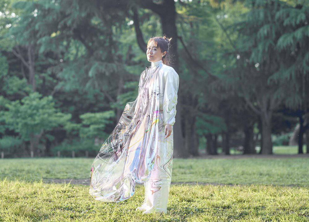 A woman wearing Fabricant's digital dress