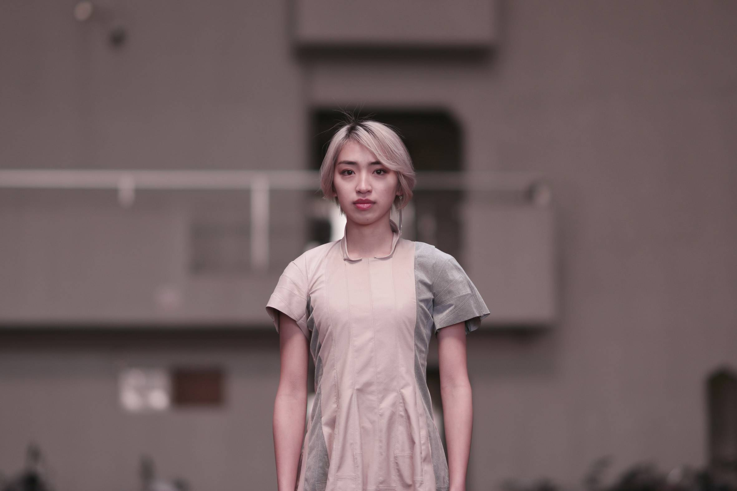 Head and torso of a blonde woman with short hair wearing a dress