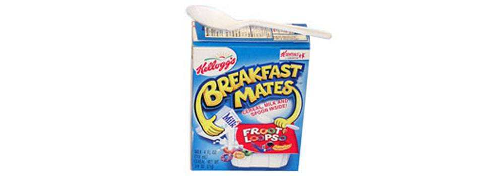 Kellogg's Breakfast Mates cereal and milk in a box with a spoon