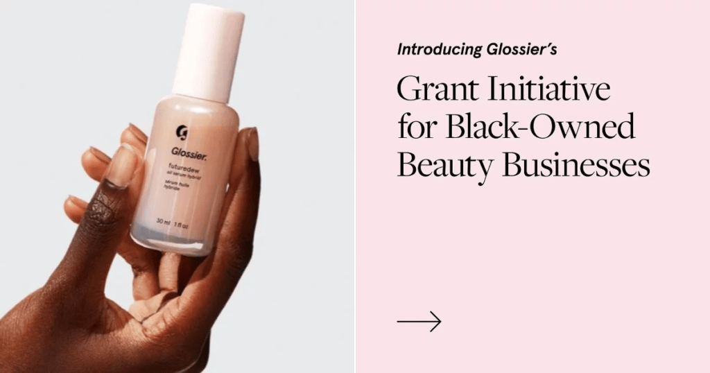Website screenshot of a hand holding Glossier nail polish and text highlighting Glossier's grant initiative for black-owned beauty businesses.