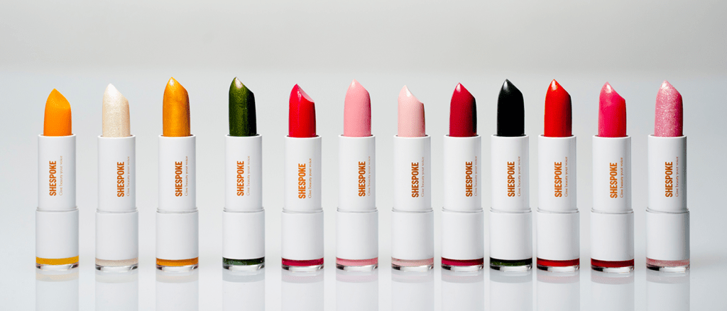Shespoke lipsticks are featured in one line with caps off to showcase their different colors.