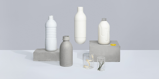 Paboco's fiber-based sustainable packaging on a gray background.
