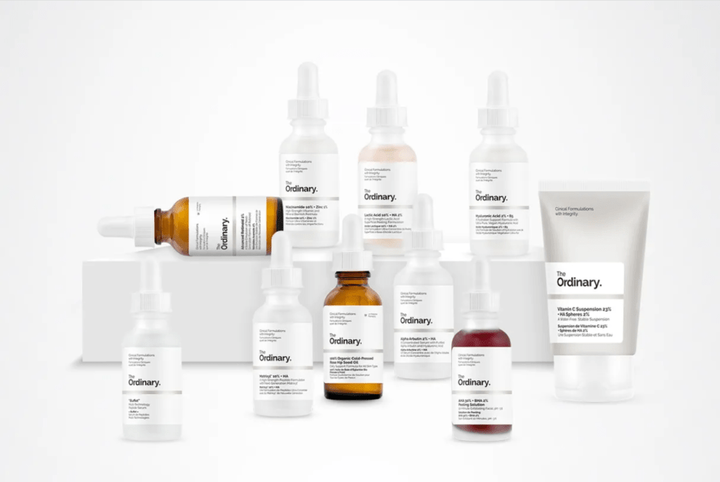 A variety of The Ordinary's skincare products arranged in front of a white background.